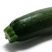 Photographie d'une courgette verte noire maraîchère